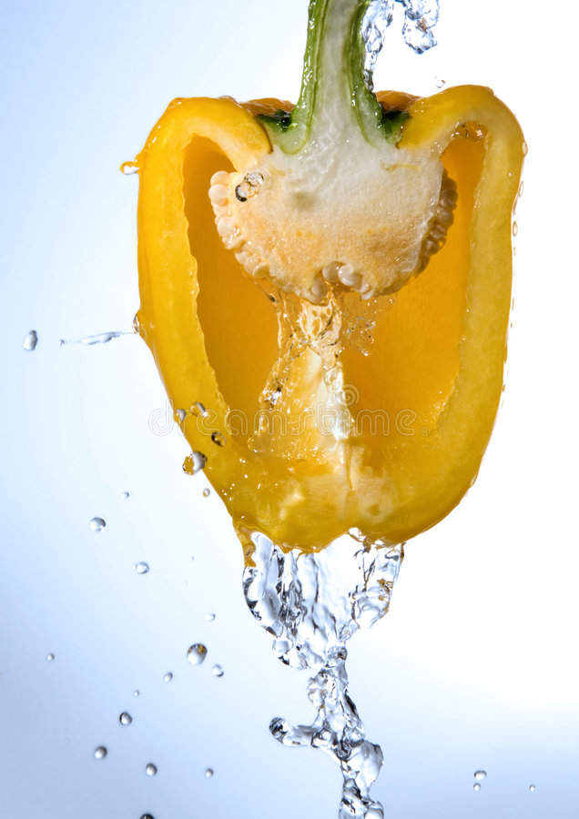 Free Half Pepper Being Washed Royalty Free Stock Photography - 3440287