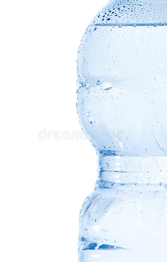 Half plastic bottle with water and drops, concept of nutrition and diet royalty free stock images