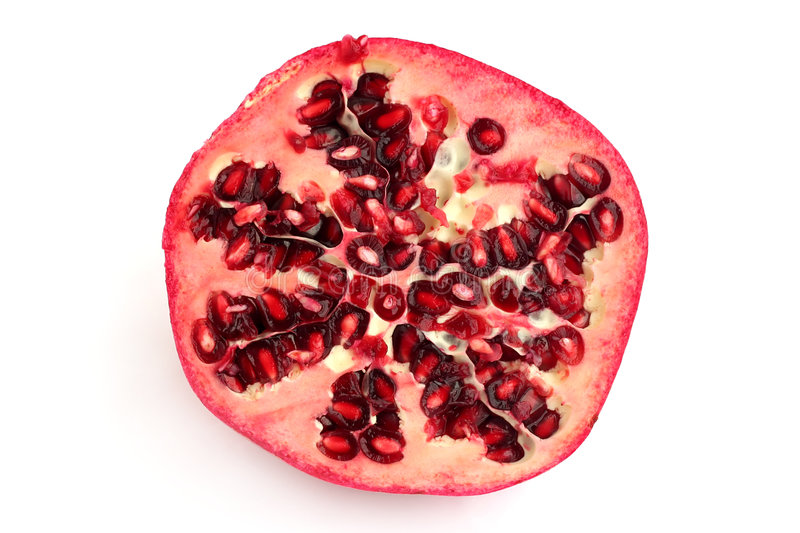 Half of pomegranate royalty free stock photo