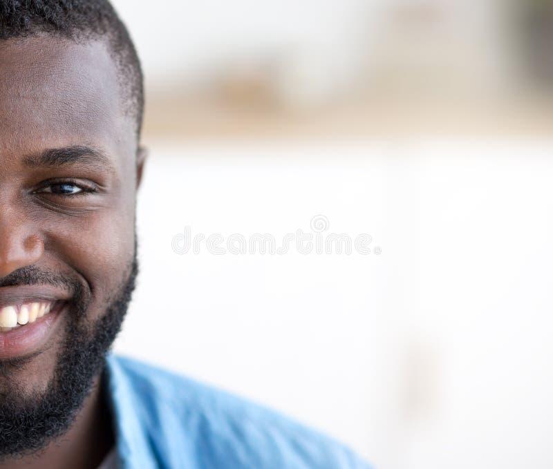 Half portrait of african american man smiling stock image