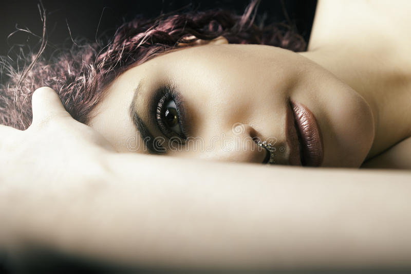 Half portrait lying girl. Young model woman make-up stock photos