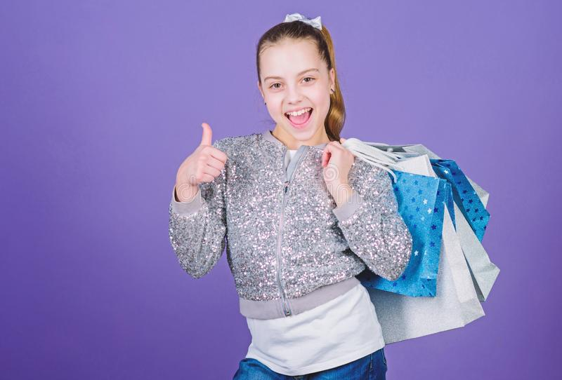 Half price. Kid fashion. shop assistant with package. Sales and discounts. Happy child. Little girl with gifts. Small royalty free stock photo