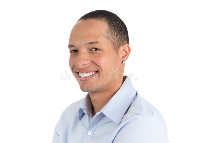 Half profile of young man. He`s Latino. Isolated on white backgr. Face profile of a young man smiling. Isolated person on white background, he wears light blue stock images
