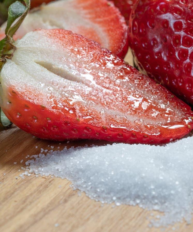 Half. Red. Sugar. Sweetness. Strawberry. Fruits. Sweetness Half Strawberry On The Sugar. Sweet Dessert. Food And Macro Photography royalty free stock photos