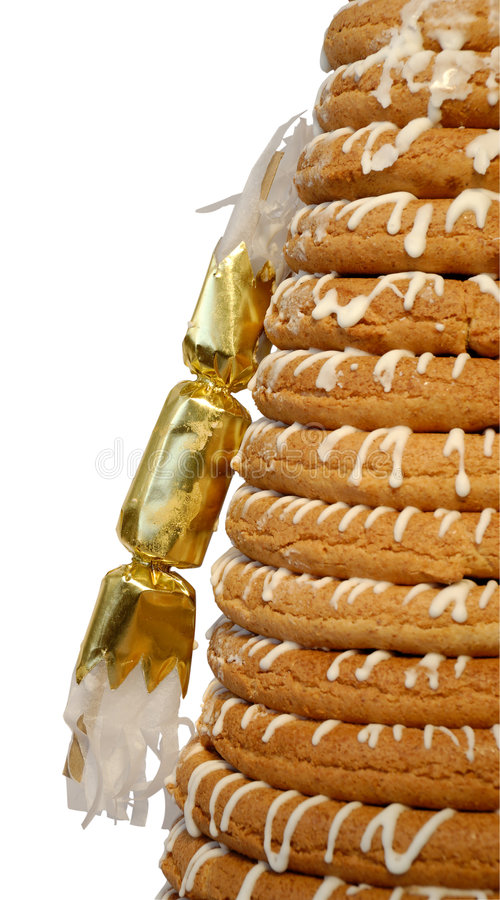 Half Ring Cake & Cracker. Traditional Norwegian marzipan ring cake - kransekake - seen from side with cracker. Isolated with clipping path royalty free stock images