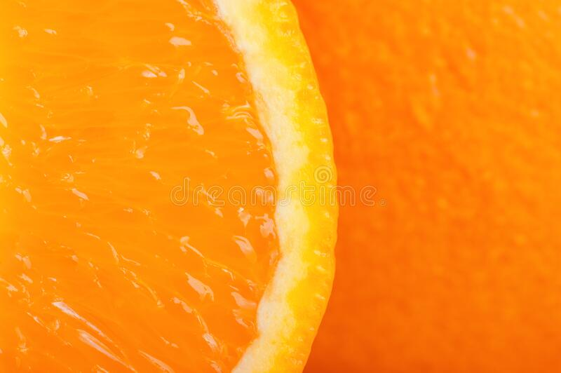 Half of a ripe orange very close up. Studio photography stock image
