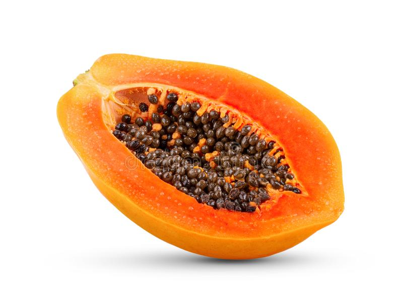 Half of ripe papaya fruit with seeds isolated on white background. Full depth of field royalty free stock image