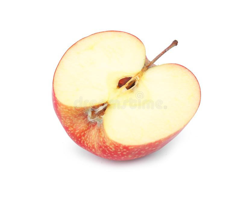 Half of ripe red apple on white. Background stock photos