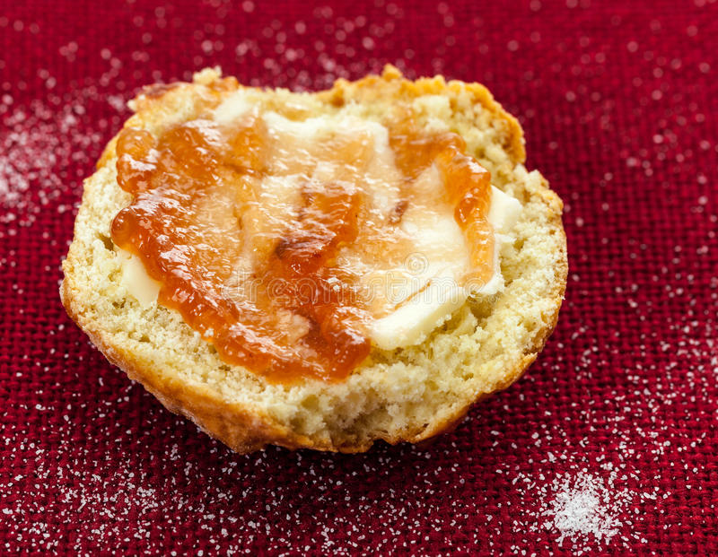 Download Half Scone With Butter And Jam On Red Tablecloth Stock Image - Image: 24630009