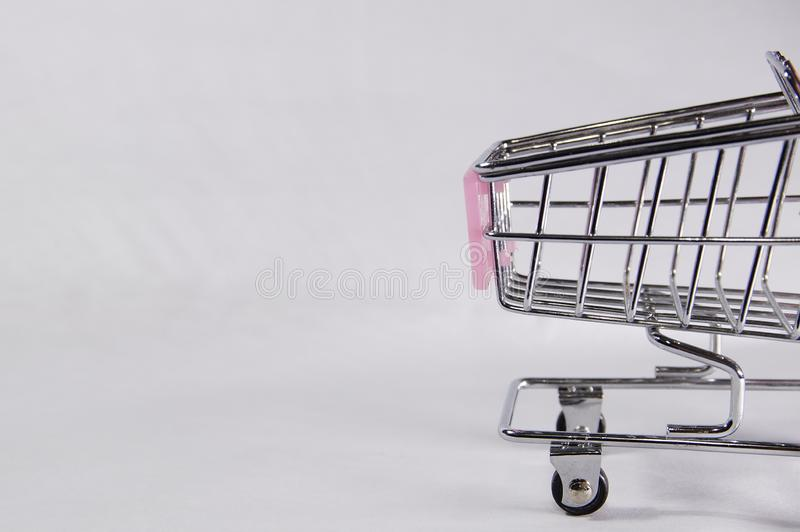 Half of shopping trolley feed in the frame stock images