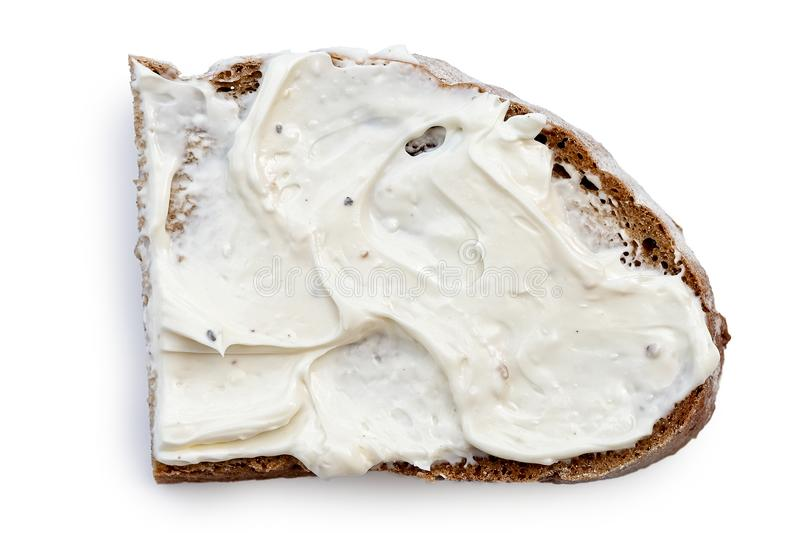 Half slice of rye bread with cream cheese spread isolated on white from above. royalty free stock photo
