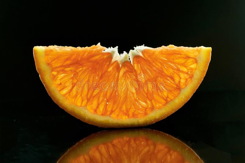 Half slices of Orange on a dark background stock images