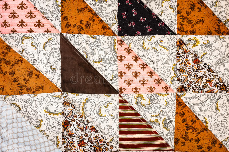Half-square Triangle Quilt Background. Browns and Pinks royalty free stock photo