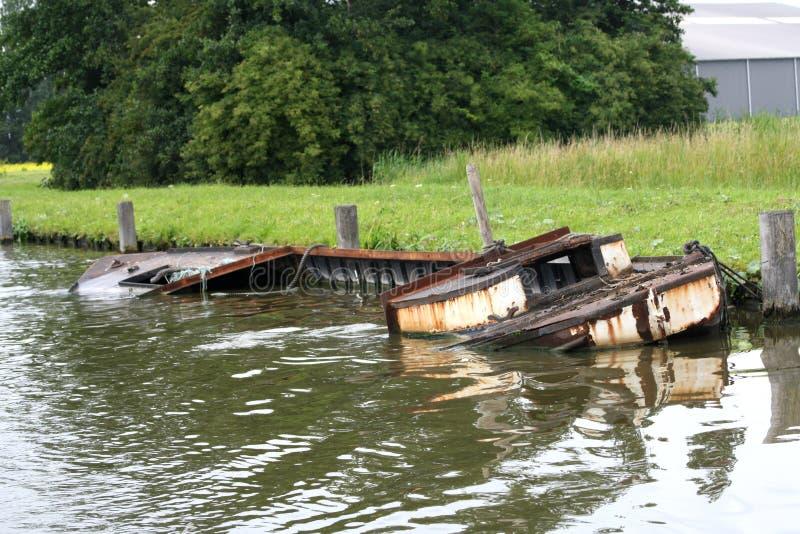 Half sunken boat stock images