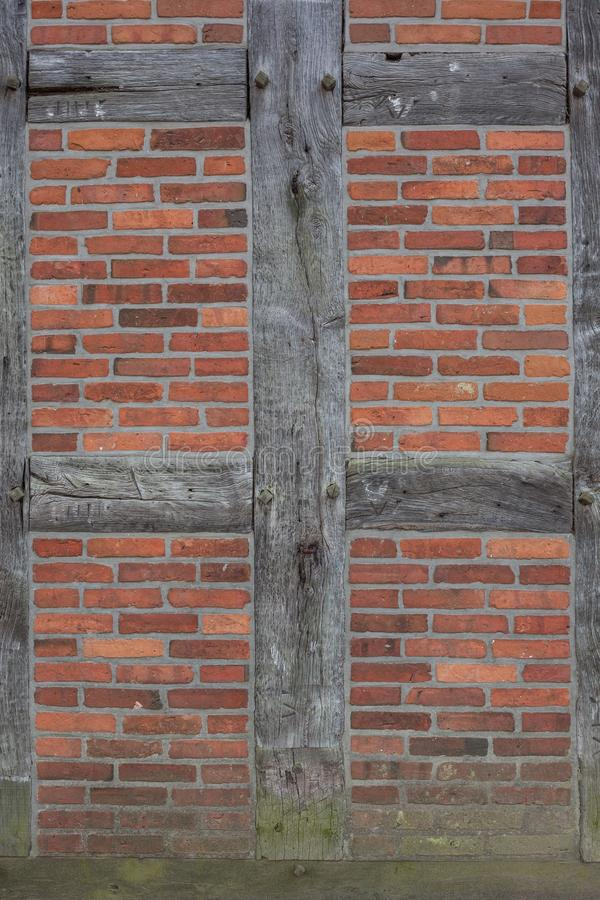 Red  brick wall background with dark wood royalty free stock photo