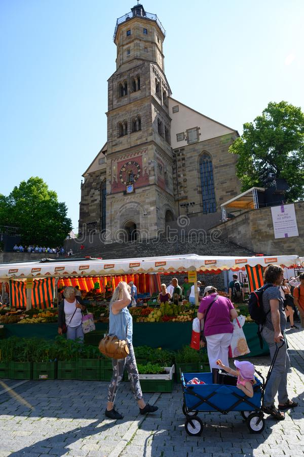 Weekly market in front of Parish Church Saint Michael, Schwabisch Hall, Baden-Wuerttemberg Schwabisch Hall, Germany. Half-timber houses and gable houses in royalty free stock image