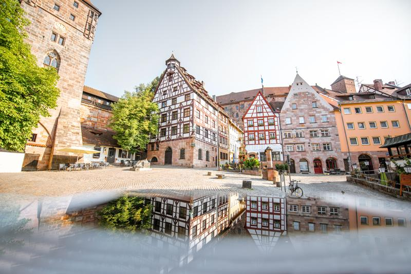 Half-timbered houses in Nurnberg, Germany. Morning view on the beautiful half-timbered houses with reflection in the old town of Nurnberg, Germany royalty free stock photo