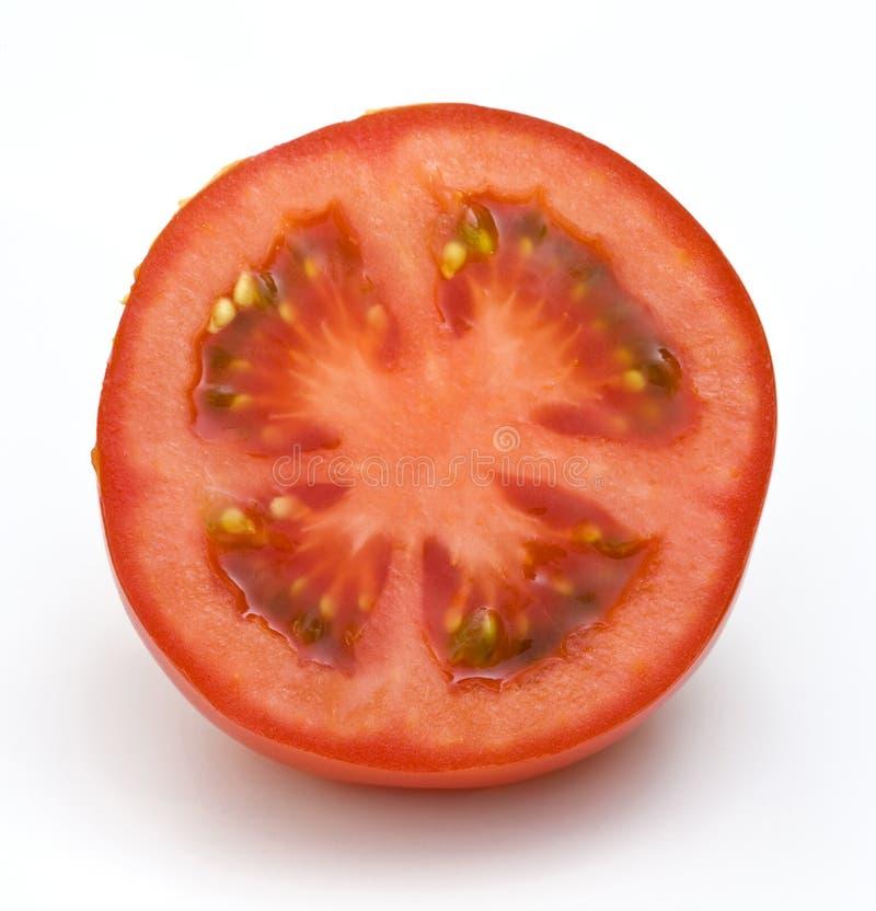 half tomatwhite för bakgrund royaltyfria foton