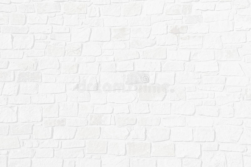 Half transparent brick wall of natural rough stones. Light grey structured background with half transparent brick wall of natural rough stones royalty free stock photography