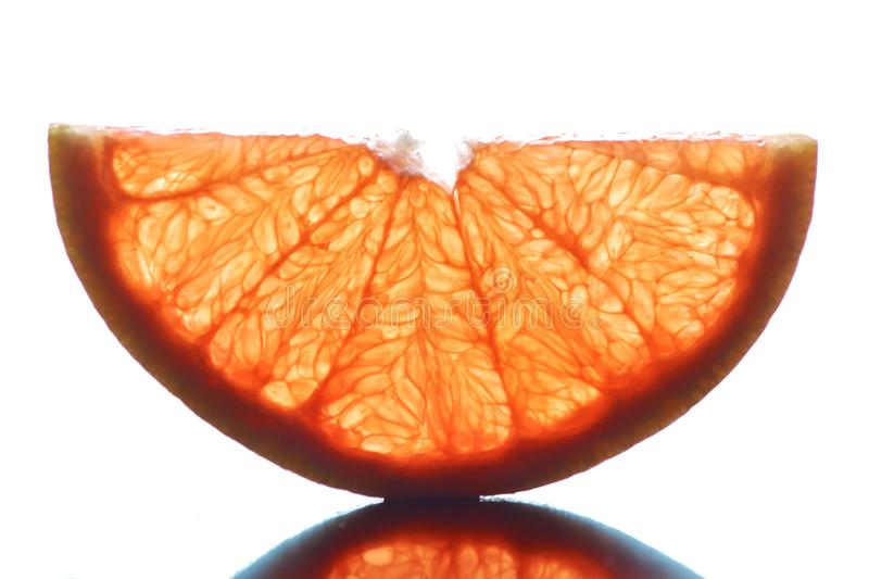 Half transparent slice of grapefruit on a white background. royalty free stock photo