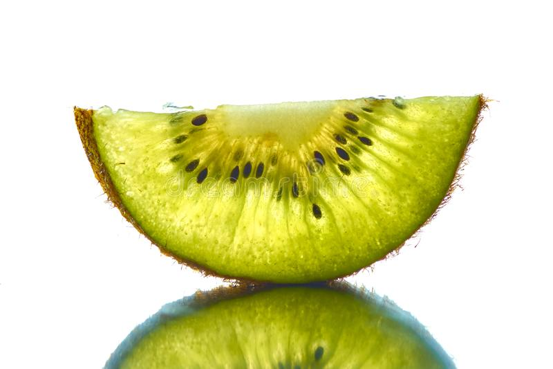 A half transparent slice of kiwi on a white background. stock photo
