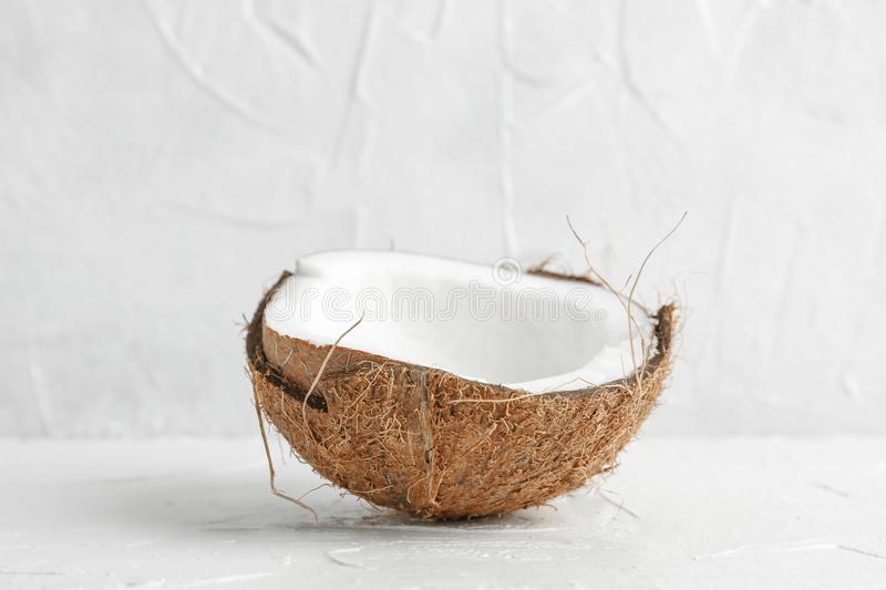 Half tropical coconut on wooden table against white background royalty free stock images