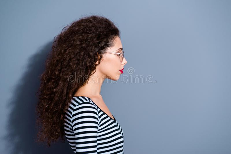 Half-turned closeup photo portrait of pretty stunning gorgeous serious concentrated charming attractive with long. Hairstyle looking to the side lady isolated royalty free stock images