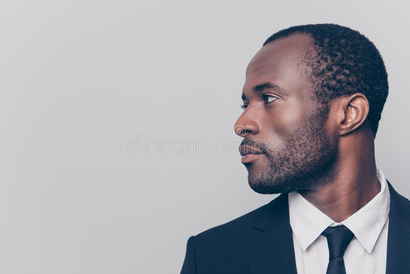 Half-turned side profile close up view portrait of handsome virile masculine attractive confident smart intelligent clever africa royalty free stock photos