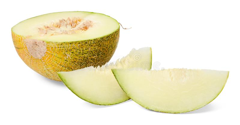 Half and two slices of fresh ripe melon on a white isolated background. Close-up. royalty free stock photography