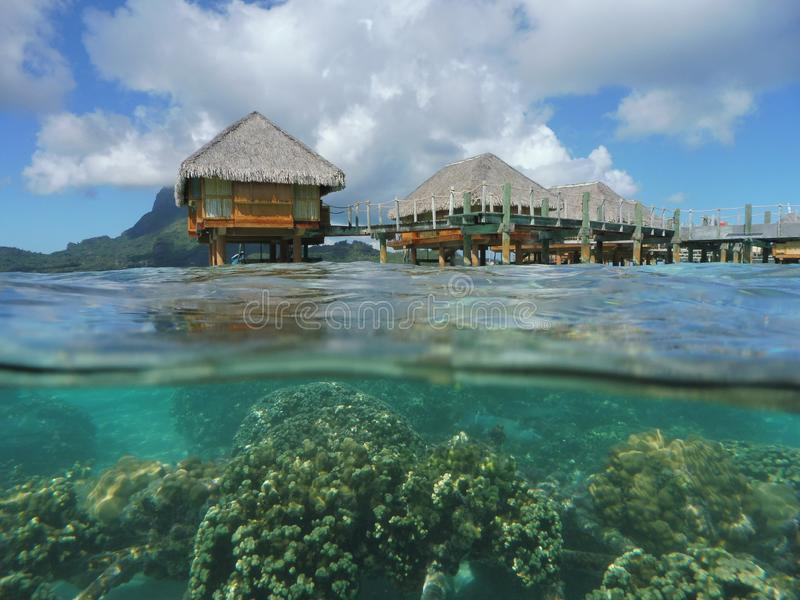 Half water half air overwater bungalows bora french polynesia stock photo