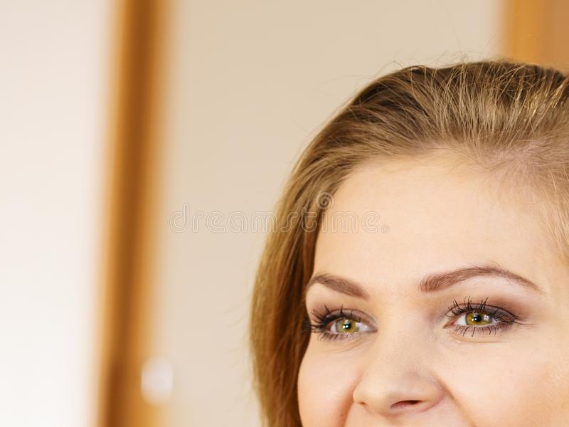 Half of woman face. Young female and her eyes royalty free stock photo