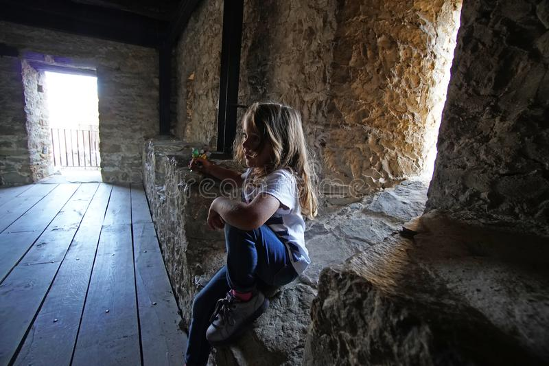 4 and a half year old girl visiting the fortress of Tzavarets stock image