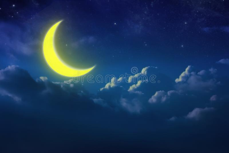 Half yellow moon behind cloudy on sky and star at night. Outdoor royalty free stock image
