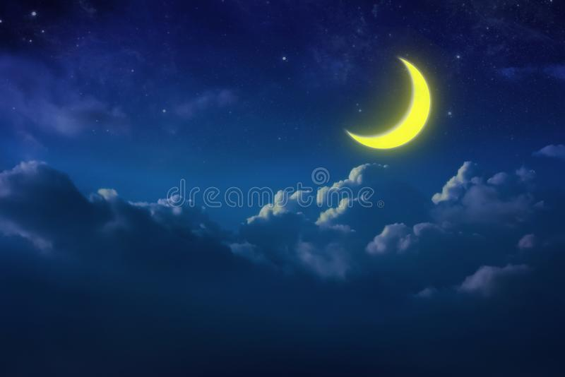Half yellow moon behind cloudy on sky and star at night. Outdoor royalty free stock photo