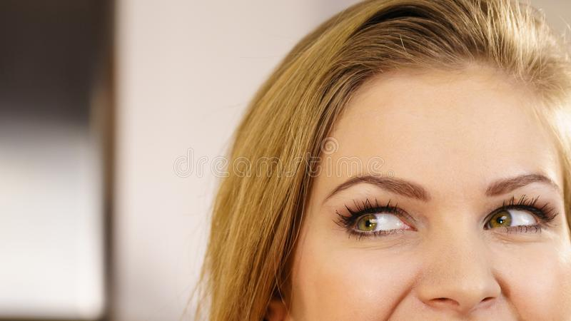 Half of woman face. Young female and her eyes stock images