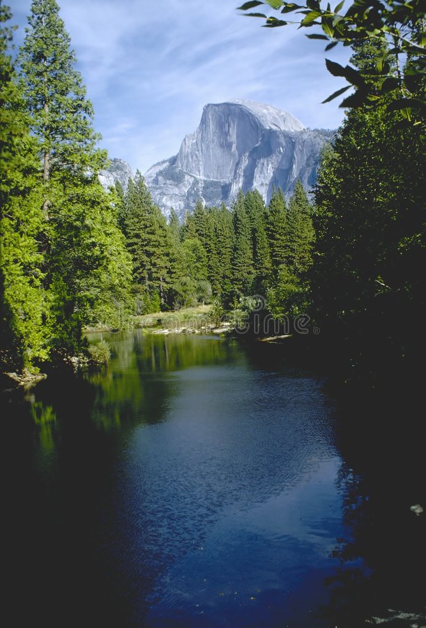Halfdome. Reflected in a lake royalty free stock images