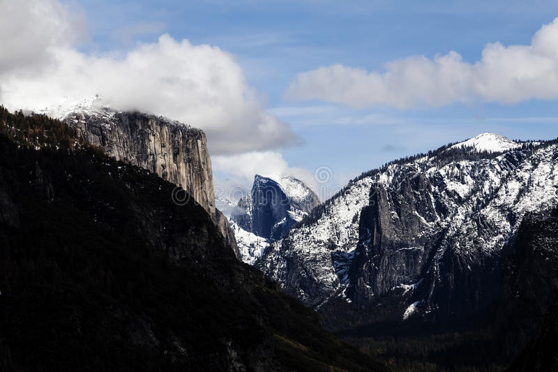 Halfdome With Snow Blue Sky White Clouds Yosemite. Snow On Halfdome In Blue Sky With White Clouds Yosemite National Park California stock images