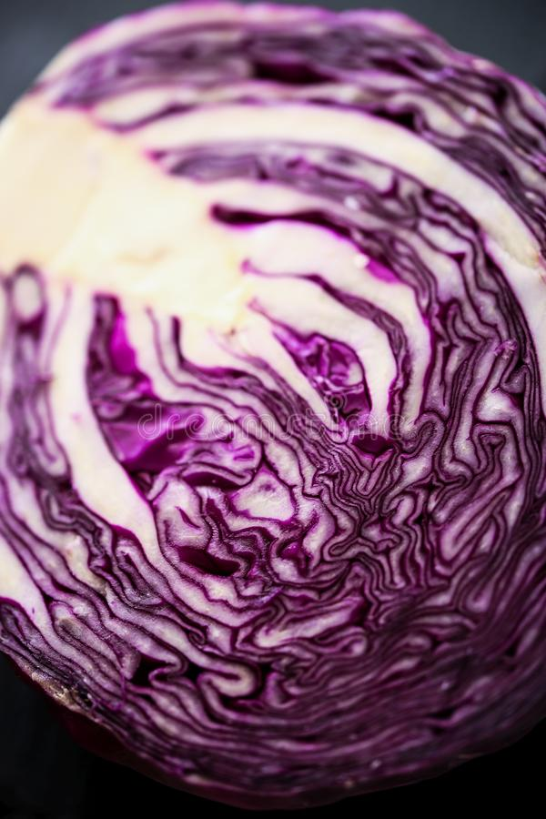 Halfed Red cabbage. On a dark background stock photography