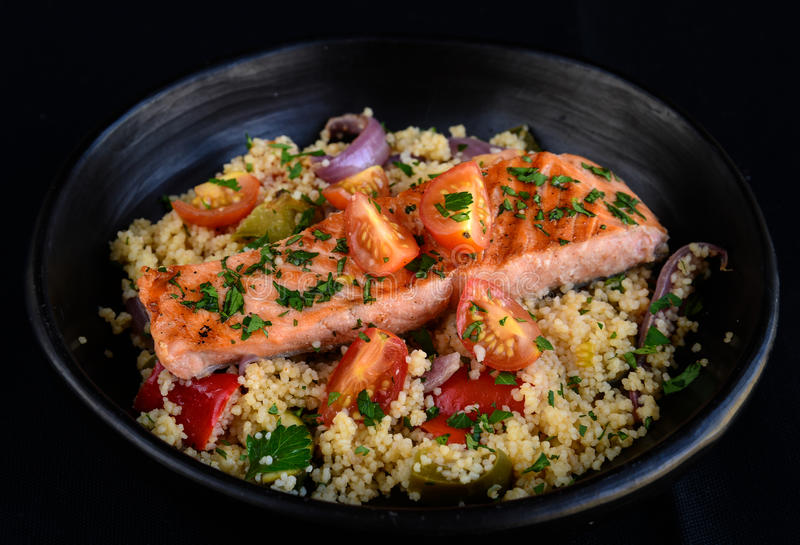 Halibut with couscous. Halibut served with couscous as meal stock photos