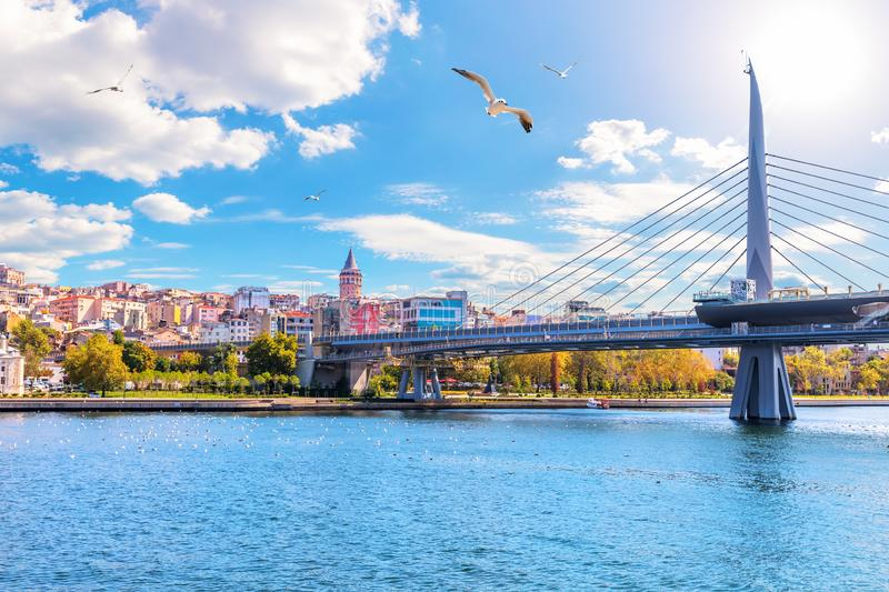 Halic Metro Bridge and Galata Tower on the background, view from the Golden Horn, Istanbul, Turkey.  stock image