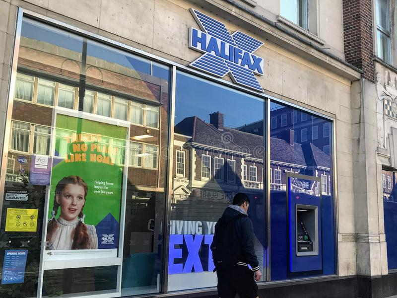 HALIFAX bank branch. Halifax previously known as Halifax Building Society is a British bank operating as a trading division of Bank of Scotland, itself a wholly stock images