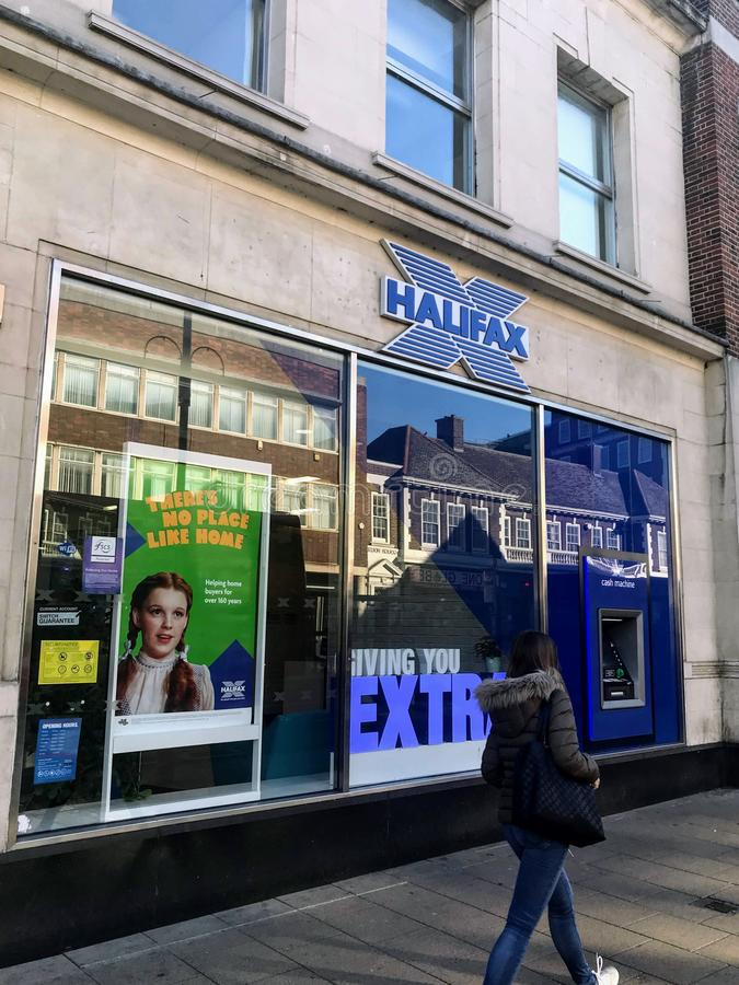 HALIFAX bank branch. Halifax previously known as Halifax Building Society is a British bank operating as a trading division of Bank of Scotland, itself a wholly royalty free stock photos
