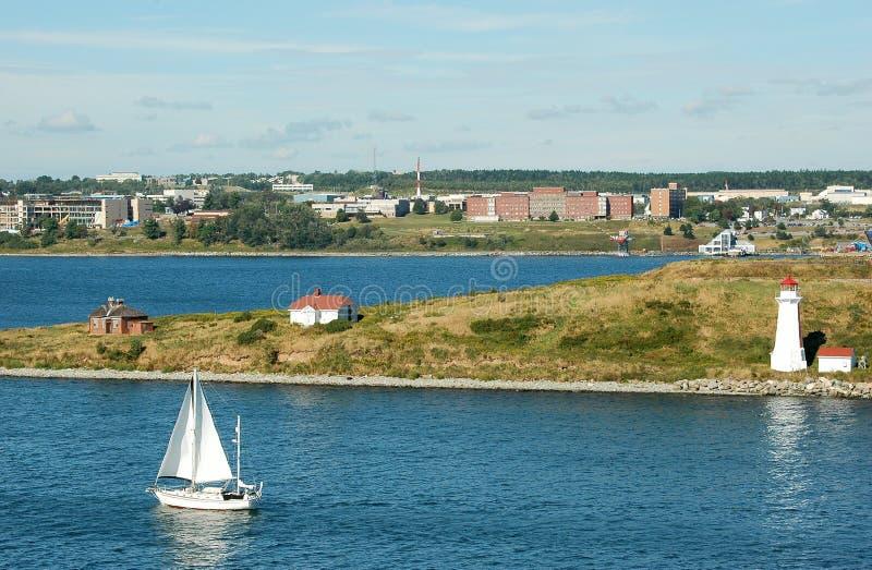 Sailboat sailing into Halifax Harbour royalty free stock photos