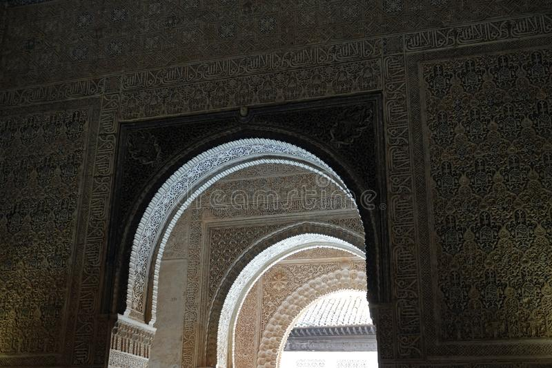 Hall of the Abencerrajes arches at Nasrid palace of the Alhambra in Granada, Andalusia. Decorations with arabesque ornaments at the Hall of Abencerrajes royalty free stock photography