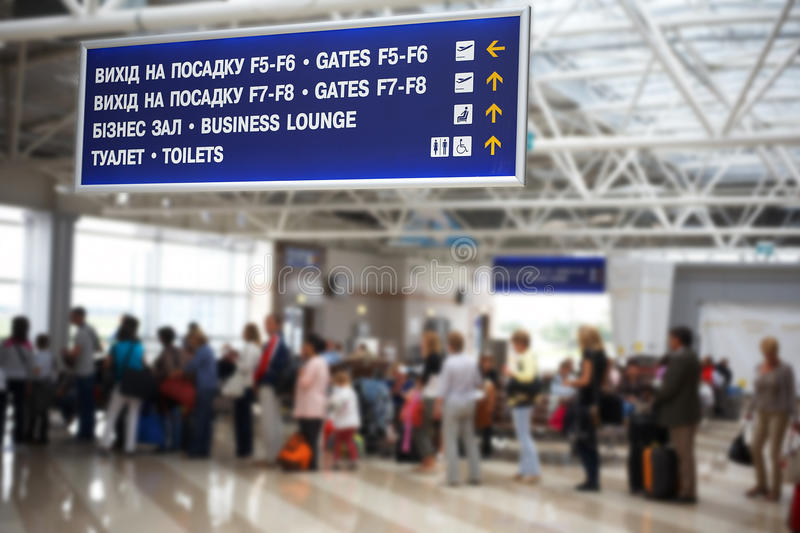 Hall of the airport. Tourist info signage in airport in international language royalty free stock photo