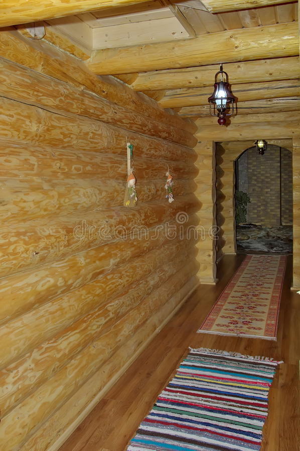 Hall in fir wooden house royalty free stock photo