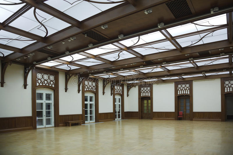 Hall with glass roof and laminate. Reflect on floor. white doors royalty free stock photo