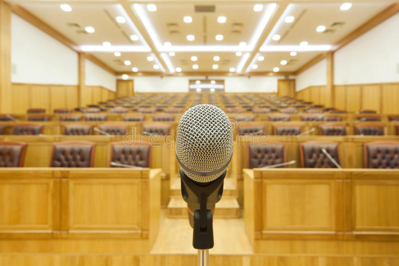 Hall government meetings. Microphone on center. royalty free stock image