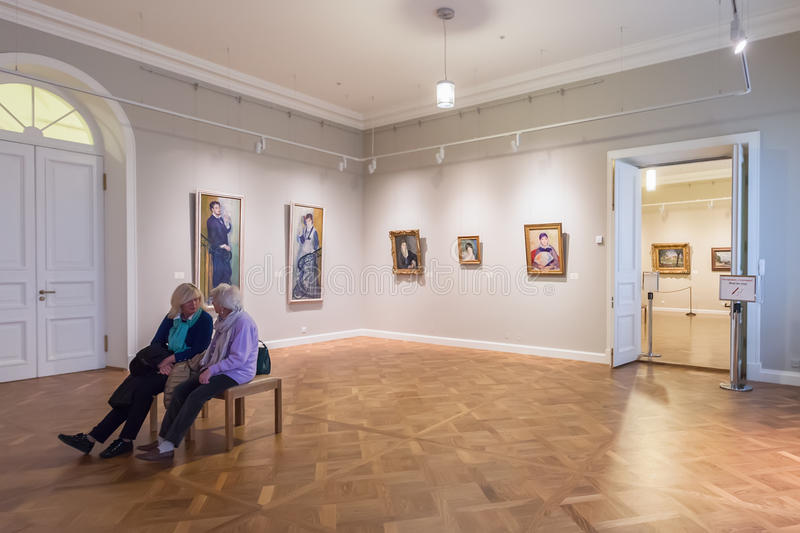 Hall with Impressionist paintings Pierre-Auguste Renoir at the royalty free stock images