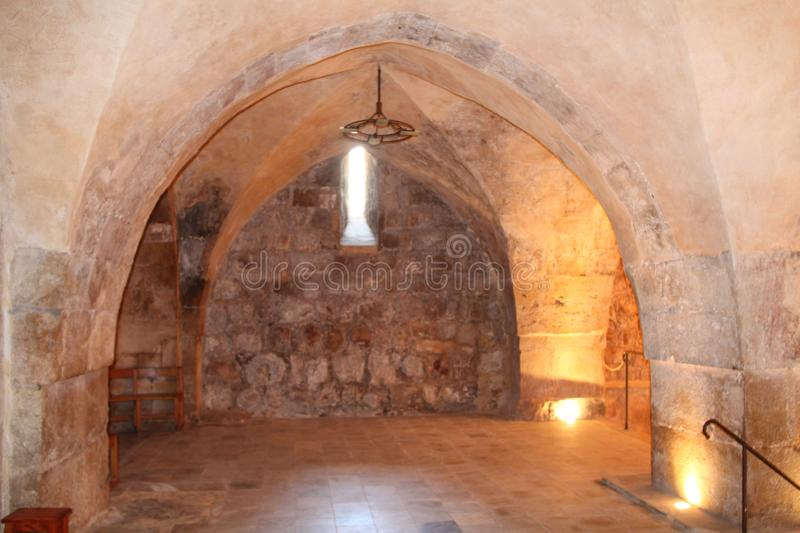 Hall Indside The Benedictine monastery in Abu Ghosh. Hall with arcs and prayer niche inside The Benedictine monastery in Abu Ghosh royalty free stock photo
